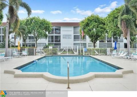 MODERN & SPACIOUS COMPLETELY RENOVATED 2 BEDS 2 BATHS CONDO WITH SCREENED LARGE BALCONY OVERLOOKING A GARDEN AND POOL AREA.